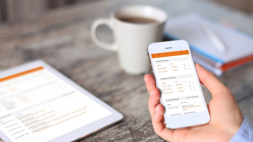 Smartphone und Ipad mit CMI Sitzungen